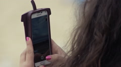 Lady using Samsung smart phone outside Stock Footage