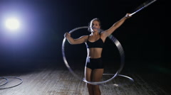 Professional female acrobatic performer rotate hula hoop on stage Stock Footage