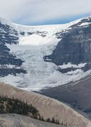Andromeda Glacier Flows Down to the Valley - stock photo