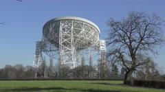 Radio telescope deep space observatory jodrell bank blue sky Stock Footage