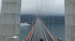 Aerial Shot Car Crossing Suspension Bridge across River in Norway. Stock Footage