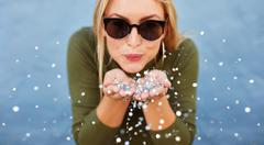 Attractive young woman blowing glitters Stock Photos