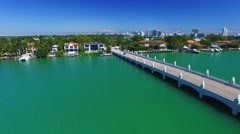 Aerial view of Palm Island and Hibiscus Island, bridge and river Stock Footage