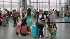 Passengers with luggage walking in Airport Stock Footage
