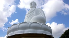 Cloudy day sky giant buddha statue Stock Footage