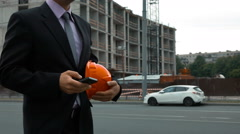 Attractive construction engineer answering call Stock Footage