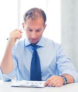 Businessman writing in notebook Stock Photos