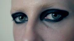 Macro portrait of woman eye with black feather, close up eye Stock Footage