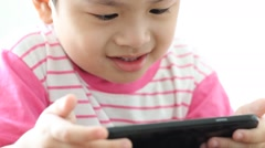 Little boy playing on the smart phone and smiling, kid looking telephone, Stock Footage