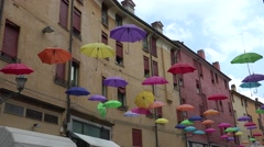Colorful umbrellas hanging above street,Ferrara, Italy, ultra hd 4k, real time Stock Footage