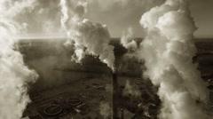 Factory Smokestacks, Steam or Smoke Swirling in Morning Sunlight Stock Footage