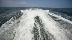 Big waves done by motorboat into the sea Stock Footage