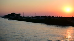 Sulina channel branch of the Danube river in Danube Delta at sunset Stock Footage