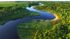 Pristine winding river amid rural wilderness, woodlands. Stock Footage
