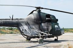 Old helicopter spraying fields Stock Photos