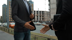Two builders are shaking hands Stock Footage