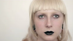 Girl in the image of albino with black lips and white eyes. Art beauty face Stock Footage