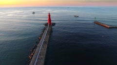 Breathtaking view of lighthouse at sunrise, aerial view Stock Footage