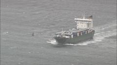 Cargo Ships Off Coast Stock Footage