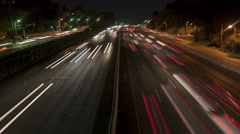 4K Time lapse freeway light trails at night Stock Footage