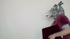 Sexy transvestite in red with girl bag and horse mask, freak and halloween Stock Footage