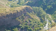 Green mountains, small river and rocks from a viewing platform in Garni, Armenia Stock Footage