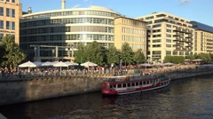 Berlin along the river spree showing diners enjoying the evening circa 20th July Stock Footage