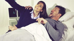 Happy couple in hospital taking selfie making funny faces Stock Footage