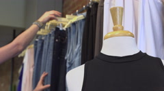 Woman browsing in a clothing store Stock Footage