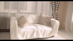 Cheerful young family of three sitting in sofa. Slow motion Stock Footage
