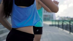 Beautiful brunette woman and handsome man in sportswear working out outdoors - stock footage