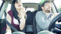 Happy funny couple dancing in car driving in vacation Stock Footage