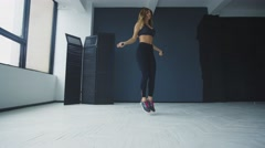 Full-length of skipping woman training at the gym working out is healthy fitness Stock Footage
