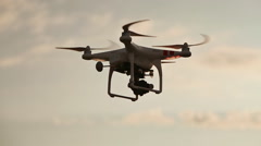 Quadcopter With Camera Flying On Sunset Stock Footage