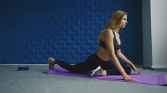 Fitness, sport, training and people concept - woman stretching leg on exercise Stock Footage