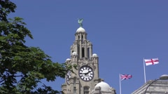 Liverpool liver bird buildingunion jack flag flying deep blue sky. Stock Footage