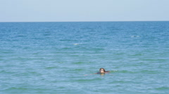 Girl Swiming in the Sea where Catamaran Boat on the Background Blurred Stock Footage