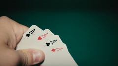 Four aces in his hands on the table Stock Footage