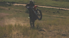 Off-road motorbike climbs the steep slope Stock Footage