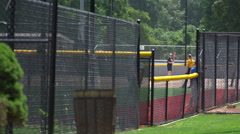 Girls softball team during practice Stock Footage