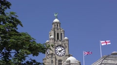 Liverpool Royal Liver Building, street scens deep blue sky flags flying Stock Footage