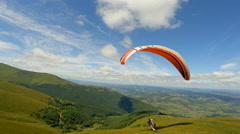 Paraglider taking off from a mountain Stock Footage