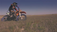 Off-road motorbike turns on the dry lake Stock Footage