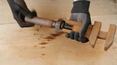 Rusty adjustable wrench on the table. Stock Footage