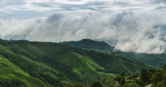Cloud and foggy on morning  over mountain and small village Stock Footage