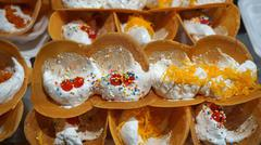 traditional asian street food with sweet cookies Stock Photos