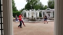 POV walk to Eva fountain, slow motion, tourists stroll around Stock Footage