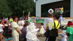 Urban park, crowd of people are resting. Stock Footage