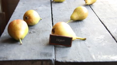 Vegan text and Juicy flavorful pears - stock footage