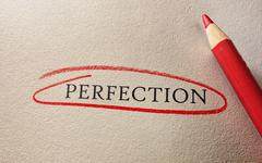 Perfection circled in red - stock photo